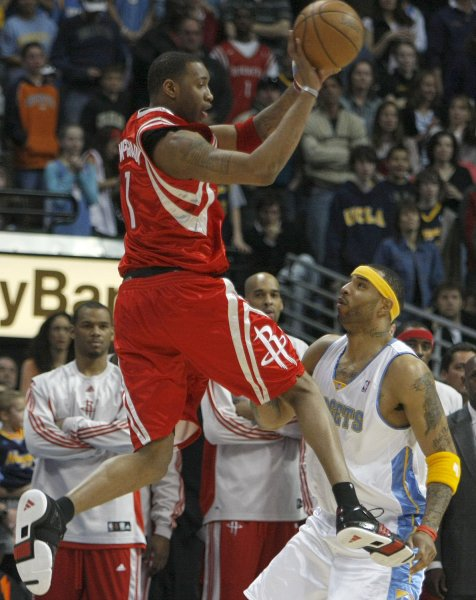 8fb5c337885e Houston Rockets guard Tracy McGrady (L) passes off while defended by Denver  Nuggets forward Kenyon Martin during the first quarter at the Pepsi Center  in ...