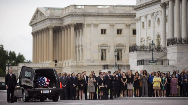 The casket containing the remains of former Sen. Frank Lautenberg (D-NJ) is removed from a hurse as former staffers and supporters of Lautenberg watch, at the U.S. Capitol Building on June 5, 2013 in Washington, D.C. Lautenberg, 89, who died Monday after complications from viral pneumonia, will lie in Lie in Repose in the Senate chamber. UPI/Kevin Dietsch