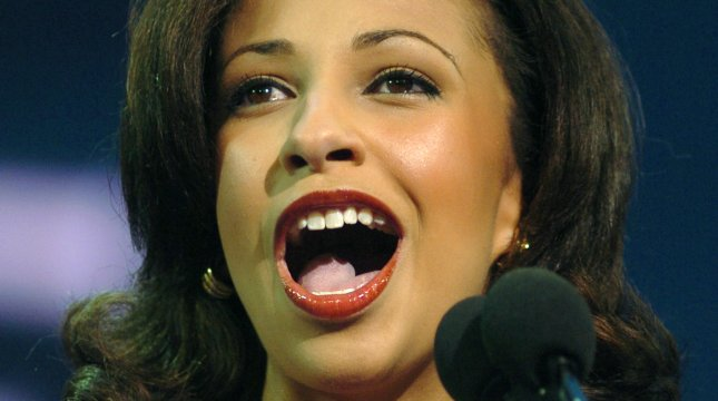 Erika Harold, Miss America, 2003, addresses the delegates during the third session of the Republican National Convention, at Madison Square Garden in New York, on Aug. 31, 2004. (UPI Photo/Roger L. Wollenberg)