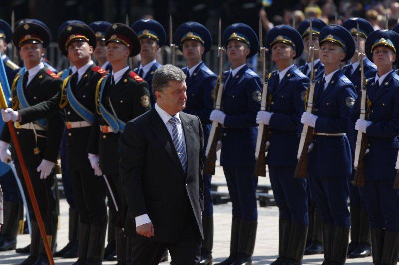 Ukrainian President Petro Poroshenko reviews an honor guard during the inauguration ceremony in Sophia Square in Kiev on June 7, 2014. (UPI/Ivan Vakolenko)