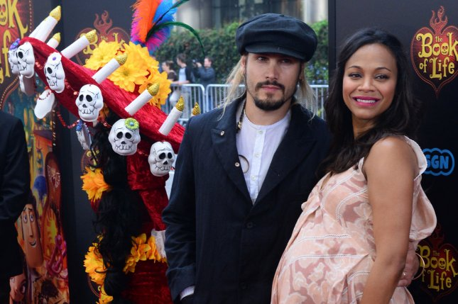 Zoe Saldana, the voice of Maria, and her husband, artist Marco Perego, attend the premiere of the animated motion picture romantic comedy The Book of Life Oct. 12, 2014. Photo by Jim Ruymen/UPI