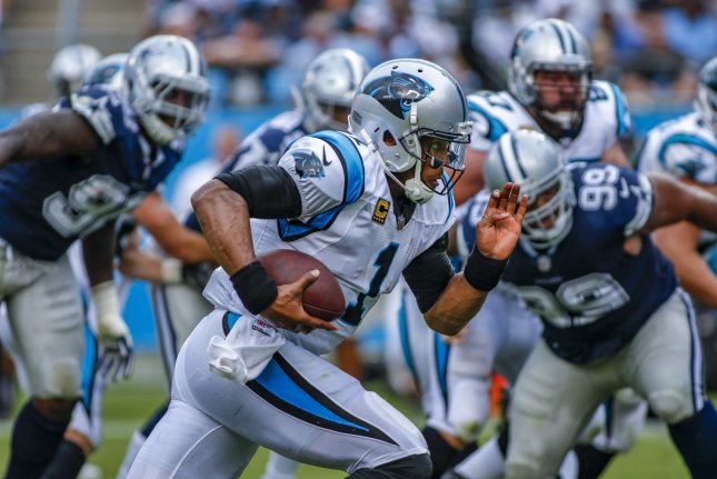 Carolina Panthers quarterback Cam Newton (1) rushes for a first-half touchdown against the Dallas Cowboys on Sunday in Charlotte, North Carolina. Photo by Nell Redmond/UPI
