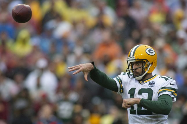 Green Bay Packers quarterback Aaron Rodgers (12) throws a pass against the Washington Redskins on Sunday at FedEx Field in Landover, Md. Photo by Alex Edelman/UPI