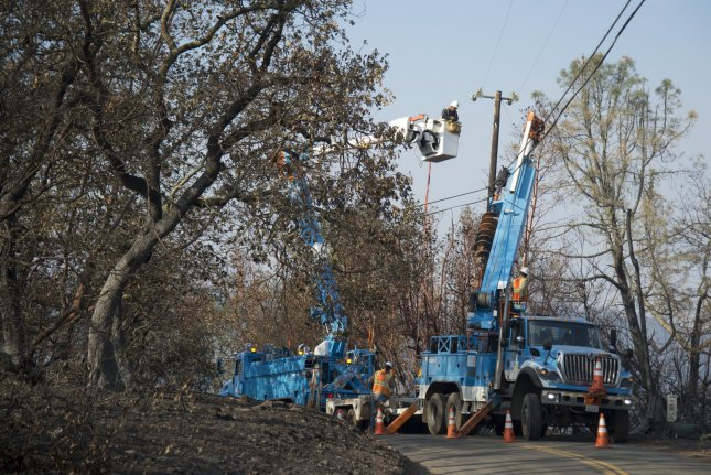 Pacific Gas and Electric crews work to restore power in Napa, Calif., on October 17, 2017, after wildfire. California regulators are considering actions against Pacific Gas & Electric Co., in the wake of deadly disasters, including the Camp Fire this year. File Photo by Terry Schmitt/UPI