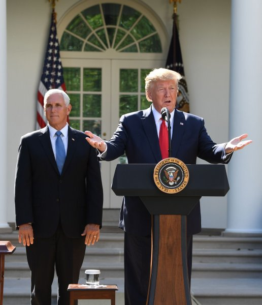 President Donald Trump, backed by Vice President Mike Pence, said he was canceling a scheduled trip to Poland as Hurricane Dorain is predicted to make landfall over the holiday weekend. Photo by Pat Benic/UPI