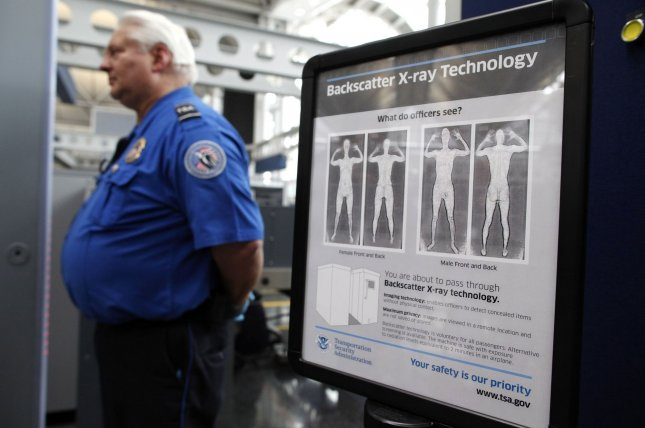 A TSA agent screens passengers at O'Hare International Airport in Chicago. File Photo by Brian Kersey/UPI
