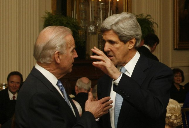 U.S. Vice President Joe Biden (L) and Sen. John Kerry (D-MA) speak to each other at a dinner for Congressional Committee chairmen and ranking committee members in the East Room of the White House in Washington on March 4, 2009. (UPI Photo/Dennis Brack/Pool)
