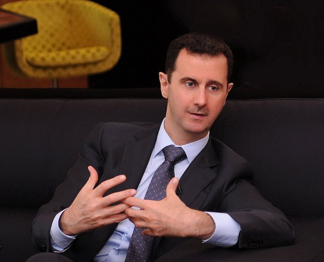 A handout photo distributed by Syrian News Agency July 3, 2012, shows Syrian President Bashar Assad during an interview with a Turkish newspaper in Damascus. UPI