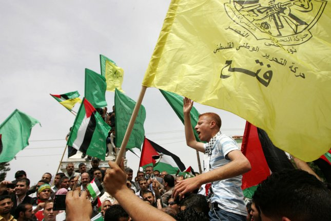 Palestinians celebrate in Gaza City the signing of the reconciliation agreement between rival factions, Hamas and Fatah, in Cairo, on Egypt, May 4, 2011. The reconciliation agreement ends four years of hostile division between Hamas and Fatah and paves the way for Palestinian general elections next year. UPI/Ismael Mohamad