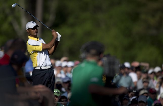 Tiger Woods watches his drive off of the 12th tee box during the second round of the Masters at Augusta National Golf Club in August, Ga., April 12, 2013. UPI/Kevin Dietsch