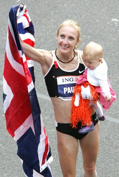 Paula Radcliffe of Great Britain, shown holding her daughter and a flag after winning the New York Marathon in 2007, has been selected for her fifth Olympic team. She'll compete for Great British next summer in the 2012 Games in London. (UPI Photo/Monika Graff).