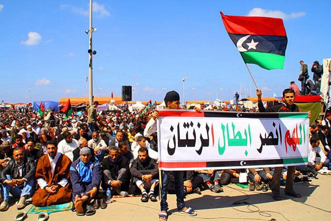 Libyans rally in Benghazi after hearing that Libyan rebels seized control of this strategic city the west gate of Benghazi on March 26, 2011, as Libyan rebels seized control of this strategic city marking their first significant victory over Colonel Kadhafi's forces since the launch of the Western-led air strikes a week ago. UPI\Mohamad shukhi.