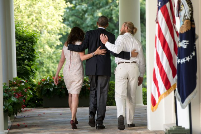 President Obama (center) walks with the parents of Sgt. Bowe Bergdahl, Jani Bergdahl (left) and Bob Bergdahl (right) back to the Oval Office after making a statement regarding the release of Sgt. Bowe Bergdahl by the Taliban in the Rose Garden at the White House in Washington, D.C. UPI/J.H. Owen/Pool