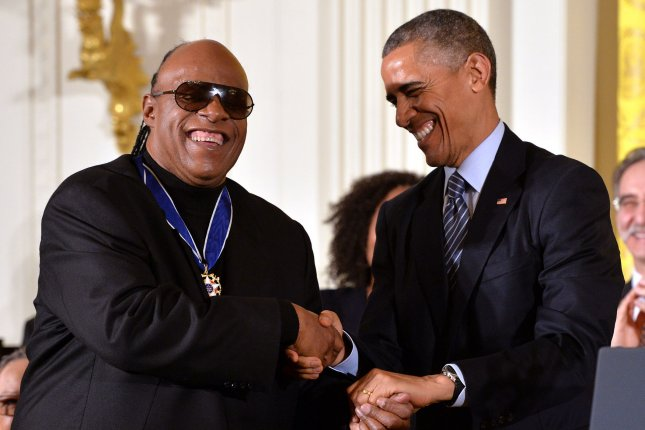 President Barack Obama awards musician Stevie Wonder a Presidential Medal of Freedom during a ceremony at the White House in Washington, D.C. on November 24, 2014. UPI/Kevin Dietsch