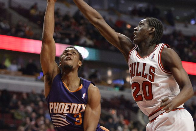 Former Phoenix Suns guard Ish Smith (L) goes up for a shot as Chicago Bulls forward Tony Snell (20) defends during the fourth quarter at the United Center in Chicago on January 7, 2014. The Bulls defeated the Suns 92-87. UPI/Brian Kersey