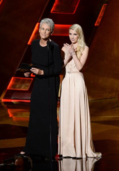 Actresses Jamie Lee Curtis (L) and Emma Roberts appear onstage during the 67th Primetime Emmy Awards at the Microsoft Theater in Los Angeles on September 20, 2015. Roberts and Curtis will return for the second season of Fox's 'Scream Queens' alongside Billie Lourd, Abigail Breslin and newcomers Taylor Lautner and John Stamos as the show transitions from a college campus to a hospital setting. Photo by Ken Matsui/UPI