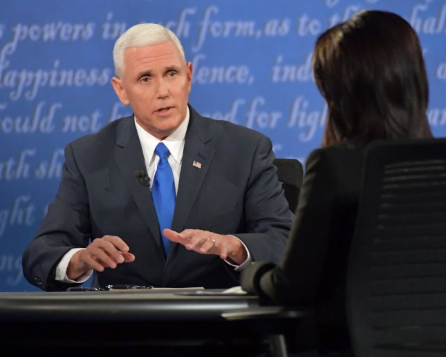 Republican vice presidential candidate Mike Pence, the governor of Indiana, speaks to moderator Elaine Quijano at Tuesday's debate. Pence affirmatively hit on all of Trump's inexplicable omissions from the last debate. Photo by Kevin Dietsch/UPI