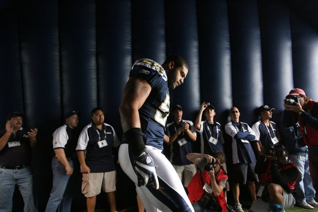 Former San Diego Chargers linebacker Shawne Merriman enters the playing field prior to a game against the Baltimore Ravens at Qualcomm Stadium in San Diego on November 25, 2007. File photo by Robert Benson/UPI