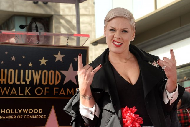Singer and songwriter Pink strikes a pose during an unveiling ceremony honoring her with the 2,656th star on the Hollywood Walk of Fame in Los Angeles on Tuesday. Photo by Jim Ruymen/UPI.