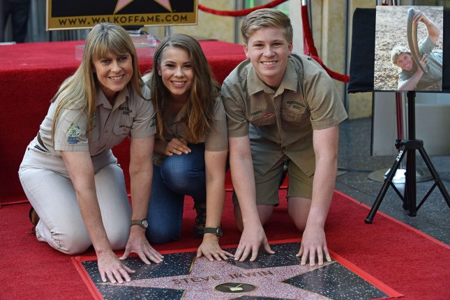 Left to right, Animal activists Terri Irwin, her daughter Bindi and son Robert attend the star unveiling ceremony for the late Steve Irwin as he is honored with the 2,635th star on the Hollywood Walk of Fame in Los Angeles in 2018. Bindi turned 23 Saturday. File Photo by Chris Chew/UPI