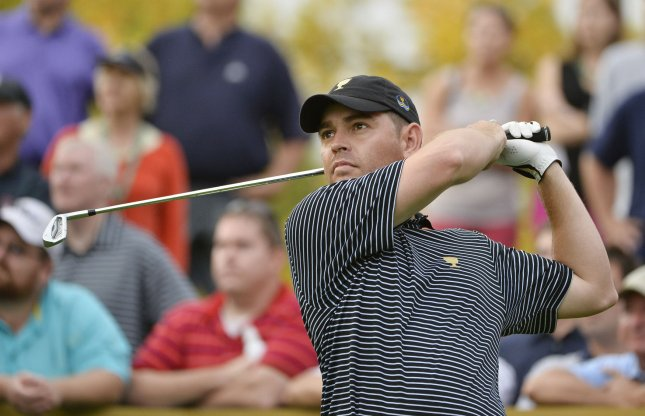 Louis Oosthuizen, shown during the 2013 Presidents Cup competition, is in second place one stroke behind leader Raphael Jacquelin after Thursday's first round of the European Tour's Volvo Golf Champions tournament in South Africa. UPI/Brian Kersey