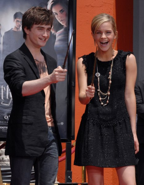 The two young stars of the Harry Potter films Daniel Radcliffe (L) and Emma Watson hold their magic wands during a hand and foot print ceremony in the forecourt of Grauman's Chinese Theatre in the Hollywood section of Los Angeles on July 9, 2007. Harry Potter and the Order of the Phoenix, the fifth film in the series, will be released worldwide this week. (UPI Photo/Jim Ruymen)..