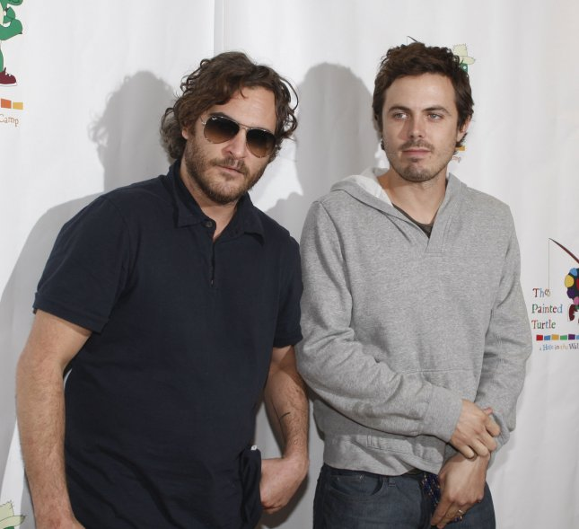 Joaquin Phoenix (L) and Casey Affleck arrive to participate in a staged reading of The World of Nick Adams, a performance to benefit Paul Newman's Hole in the Wall California Camp, The Painted Turtle, at Davies Symphony Hall in San Francisco on October 27, 2008. (UPI Photo/Terry Schmitt)