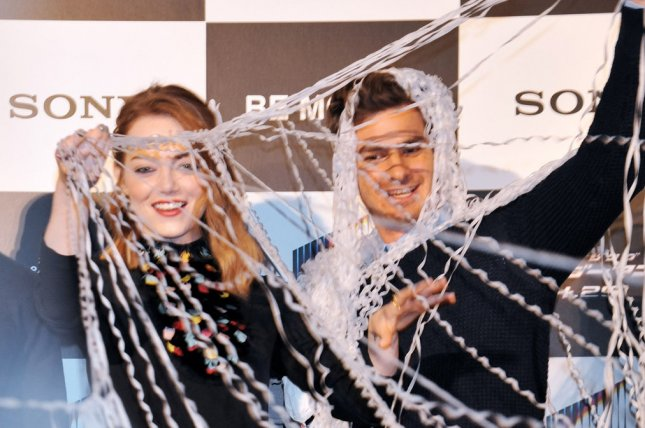 Actress Emma Stone(L) and actor Andrew Garfield attend a stage greeting for the film The Amazing Spider-Man 2 in Tokyo, Japan, on March 31, 2014. UPI/Keizo Mori