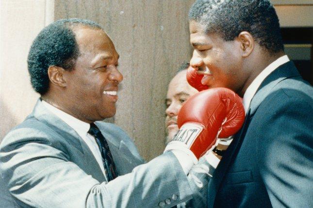 District of Columbia Mayor Marion Barry (L) playfully punches former heavyweight boxer Riddick Bowe in 1990. (UPI Photo/Jennifer Law/Files)