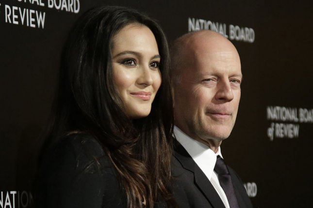 Bruce Willis (R) and wife Emma Heming enjoyed a family dinner with the actor's three eldest daughters this week. File photo by John Angelillo/UPI