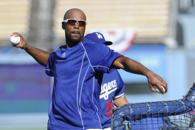 Former Los Angeles Dodgers shortstop Jimmy Rollins throws pitches during batting practice in the heatwave before game 2 of the National League Division Series against the New York Mets at Dodger Stadium in Los Angeles on October 9, 2015. UPI/Lori Shepler