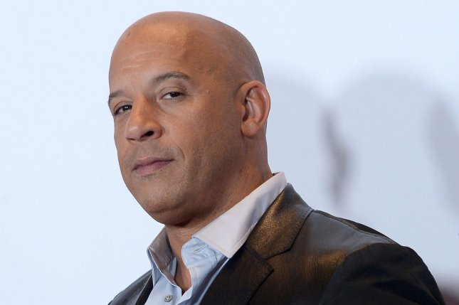 Vin Diesel appears backstage with his award for Favorite Movie and Favorite Action Movie for Furious 7 during the 42nd annual People's Choice Awards on January 6, 2016. Diesel has once again teased to reveal everything regarding his rumored Fast 8 feud with Dwayne Johnson. File Photo by Jim Ruymen/UPI