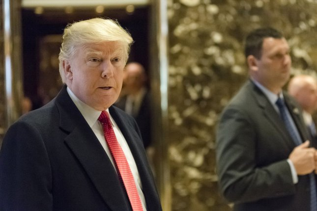 President-elect Donald Trump, shown here making a rare appearance in the Trump Tower lobby Tuesday morning, plans to attend the Army-Navy game on Saturday. Pool Photo by Albin Lohr-Jones/UPI
