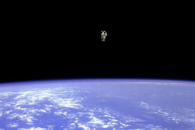 On Feb. 12, 1984, astronaut Bruce McCandless, ventured further away from the confines and safety of his ship than any previous astronaut had ever been. This space first was made possible by a nitrogen jet propelled backpack, previously known at NASA as the Manned Manuevering Unit or MMU. After a series of test maneuvers inside and above Challenger's payload bay, McCandless went free-flying to a distance of 320 feet away from the Orbiter. This orbital panorama view shows McCandless out there amongst the black and blue of Earth and space. NASA/UPI