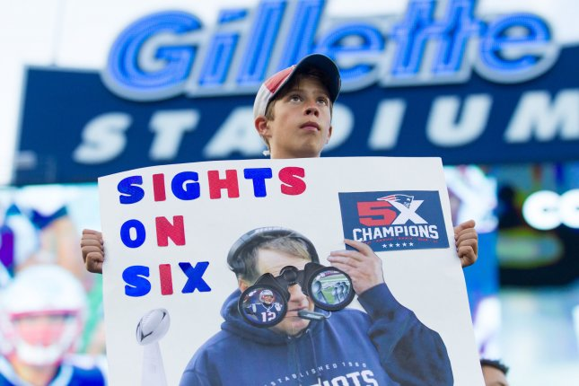 A young New England Patriots fan holds a sign calling for a sixth Super Bowl win during warm ups before a preseason game against the Jacksonville Jaguars at Gillette Stadium on August 10 in Foxborough, Mass. Photo by Matthew Healey/ UPI