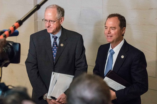 Rep. Mike Conaway, R-Texas, (L) announced Republicans are shutting down the House intelligence committee's probe into Russian election meddling, but Rep. Adam Schiff, D-Calif., said doing so would leave too many questions unanswered. File Photo by Ken Cedeno/UPI