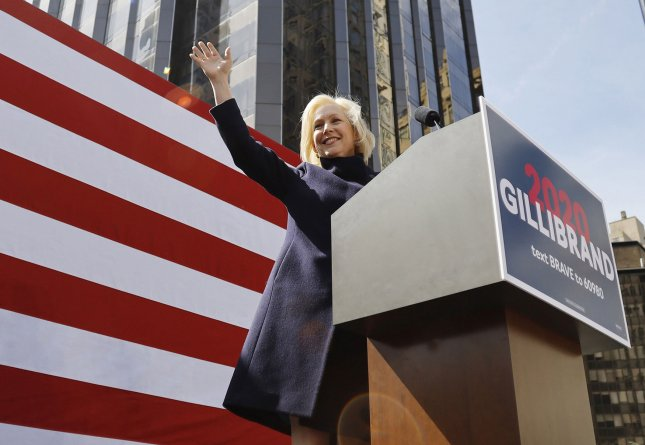 Sen. Kirsten Gillibrand waves when she arrives to speak when she officially launches her presidential campaign on Central Park West in New York City on Sunday. Photo by John Angelillo/UPI