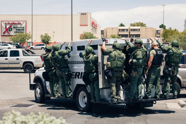 Police respond to a mass shooting at Walmart and the Cielo Vista Mall in El Paso, Texas, on Saturday. Photo by Justin Hamel/UPI