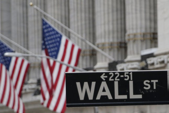 The Dow Jones Industrial Average rose 185 points on Thursday, while gold futures hit another record price. File Photo by John Angelillo/UPI