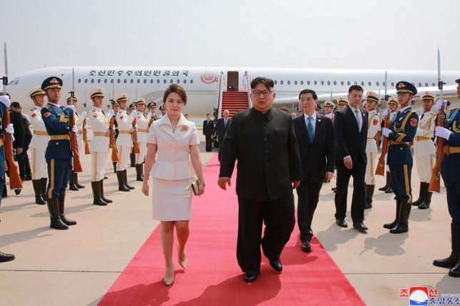 North Korean first lady Ri Sol Ju (L) has been copied for her style of makeup, according to defector Kang Na-ra. File Photo by KCNA/UPI