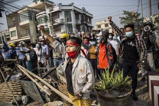 Civilians rally during a protest against the military regime in Mandalay, Myanmar, on February 28. The military junta took power in a coup on February 1. File Photo by Xiao Long/UPI