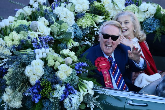 The 125th Tournament of Roses Parade grand marshal Vince Scully waves as he rides down Colorado Blvd. in Pasadena, California on January 1, 2014. Scully kicked of the festivities with his trademark hi everybody, and a very pleasant good day to you... UPI/Jim Ruymen