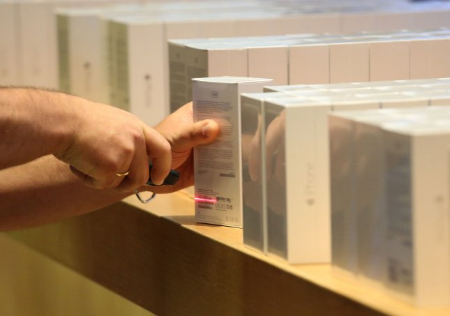 An Apple employee scans a box containing the new iPhone 6 at the Apple Store near Place de l'Opera following the release of the next generation devices today in Paris on September 19, 2014. The iPhone 6 and the larger iPhone 6 Plus feature improved camera autofocus, increased storage capacity, and NFC Apple Pay mobile wallet. UPI/David Silpa