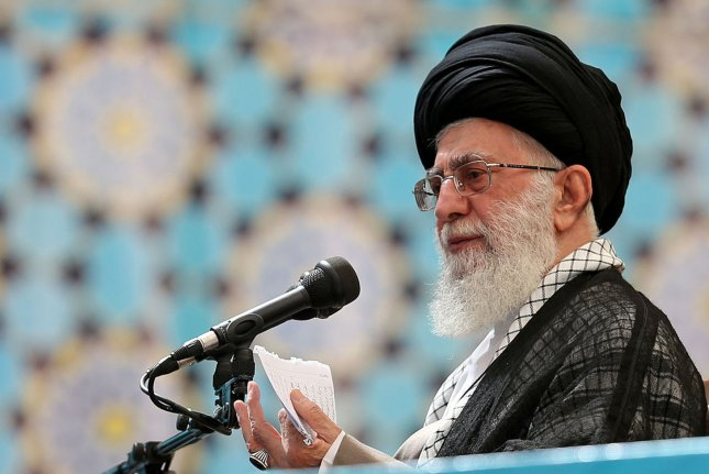 Iran's current supreme Leader Ayatollah Khamenei speaks at the 25th anniversary of the death of founder of Islamic Revolution, Ayatollah Khomeini at his shrine in Tehran, Iran on June 4, 2014. Khamenei endorsed the Joint Comprehensive Plan of Action Wednesday, but warned against American aggression. Last week, Khamenei warned against further forbidden negotiations with the United States on topics other than the recent nuclear agreement.File photo by UPI/Leader.ir/HO