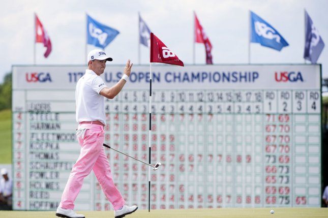 Justin Thomas waves to the fans as prepares to putt on the 18th green during round 3 of the 117th U.S. Open golf tournament at Erin Hill golf course on June 17, 2017 in Erin, Wisconsin. Photo by Kevin Dietsch/UPI