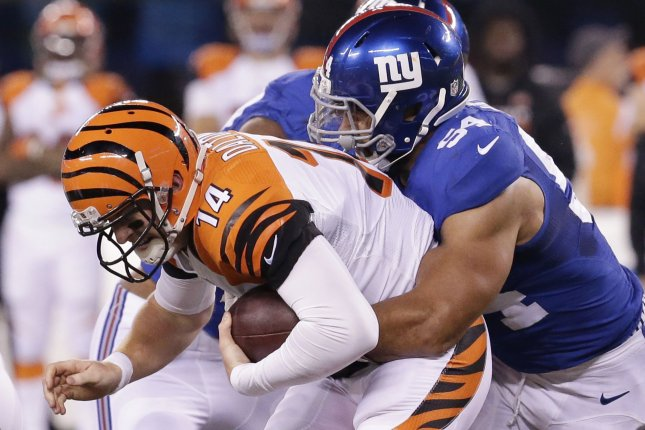 Cincinnati Bengals quarterback Andy Dalton (14) is sacked for a seven-yard loss by New York Giants defender Olivier Vernon (54) in the fourth quarter in Week 10 of the NFL season on November 14, 2016 at MetLife Stadium in East Rutherford, New Jersey. File photo by John Angelillo/UPI