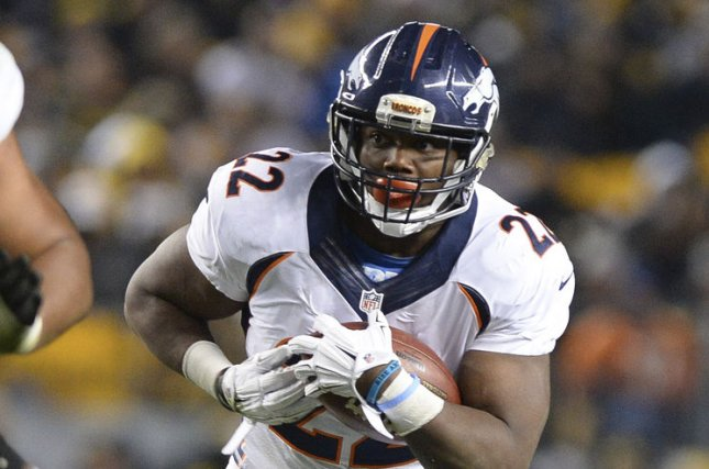 Former Denver Broncos running back C.J. Anderson (22) rushes for a gain of two yards during the second quarter against the Pittsburgh Steelers on December 20, 2015 at Heinz Field in Pittsburgh. File photo by Shelley Lipton/UPI