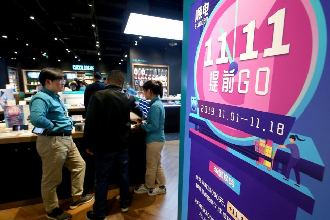 Chinese visit an international shopping mall on China's Singles Day in Beijing on Monday. E-commerce giant Alibaba said it set a sales record by the afternoon. Photo by Stephen Shaver/UPI