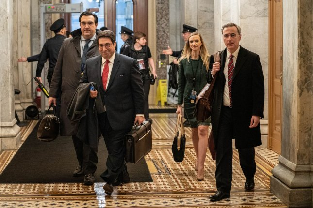 Members of President Donald Trump's defense team, attorney Jay Sekulow and White House counsel Pat Cipollone, enter the U.S Capitol on Saturday to begin their opening arguments. Photo by Ken Cedeno/UPI