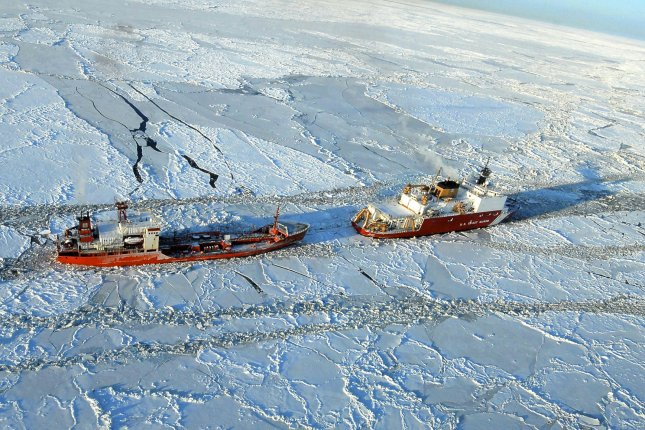 The U.S. Coast Guard Cutter Healy escorts the Russian tanker Renda 250 miles south of Nome, Alaska in the Bering Sea. The vessels are transiting through ice up to five feet thick as the tanker Renda carries 1.3 million gallons of fuel to Nome. (UPI/Sara Francis/U.S. Coast Guard)